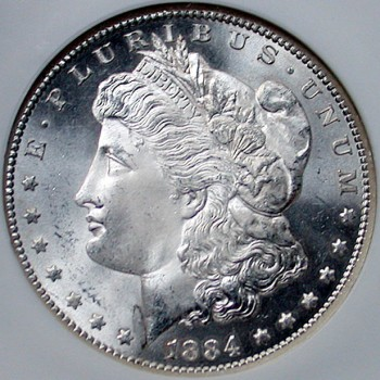click for larger picture of 1884 CC Morgan Dollar