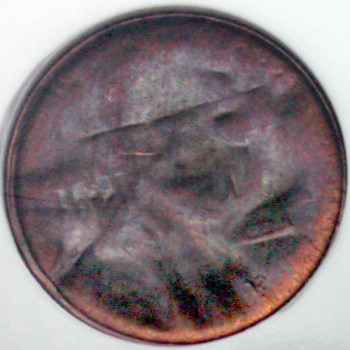 click for larger picture of Lincoln Memorial Cent Struck Through Capped Die Error